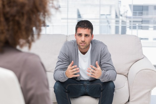 Man in psychotherapy session