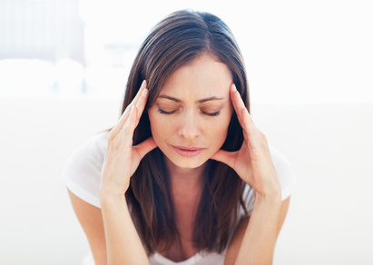Woman suffering from headacheTension headaches can be caused by sinus infections
