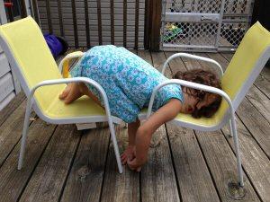 funny-little-girl-sleeping-on-chairs